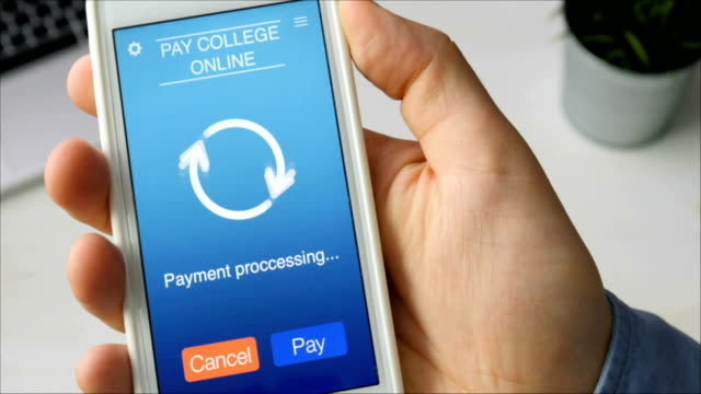 Paying for college education online using smartphone app Paying for college education online using smartphone app Stock footage debt stock videos & royalty-free footage