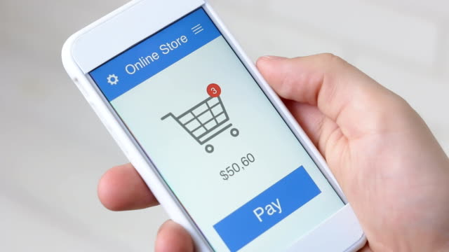 paying for online shopping using smartphone application - conto corrente video stock e b–roll