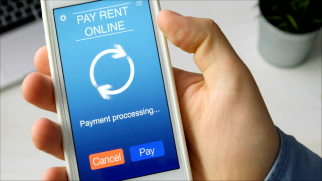 Paying for rent online using smartphone app Paying for rent online using smartphone app Stock footage house rental stock videos & royalty-free footage