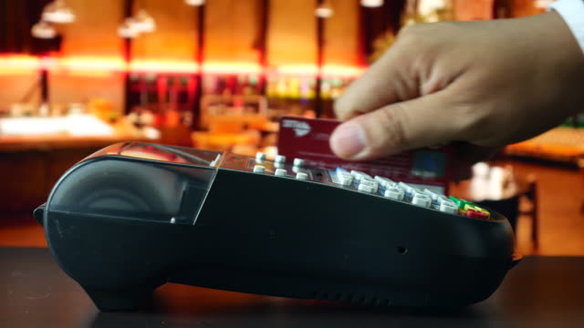 Paying with credit card in restaurant video