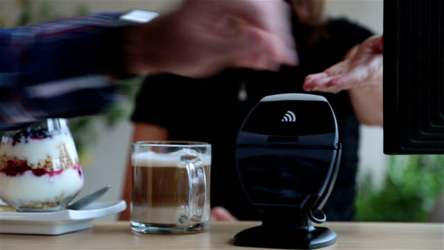 paying with nfc technology on smart watch in coffee shop - contactless payment stock videos & royalty-free footage