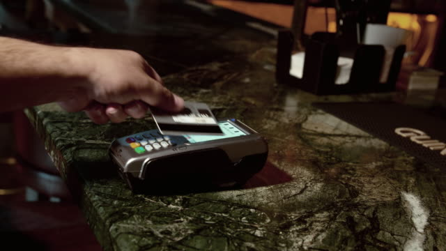paying with wireless credit card in a bar - contactless payment stock videos & royalty-free footage