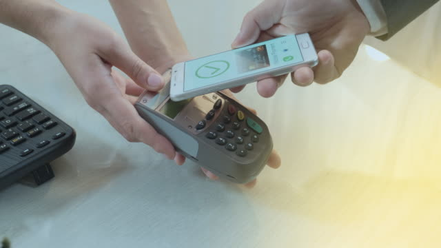 Payment Application on Smartphone Used for Contactless Payment On Terminal