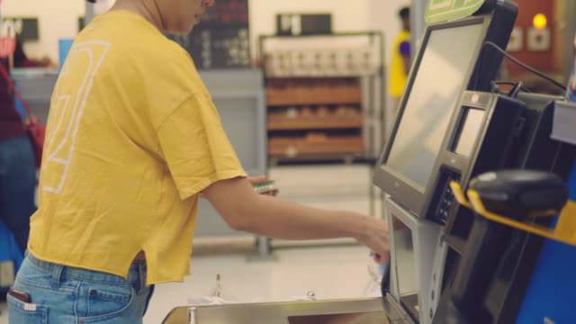Payment at cash in the store