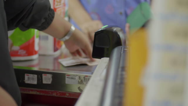 Payment at cash in the store video