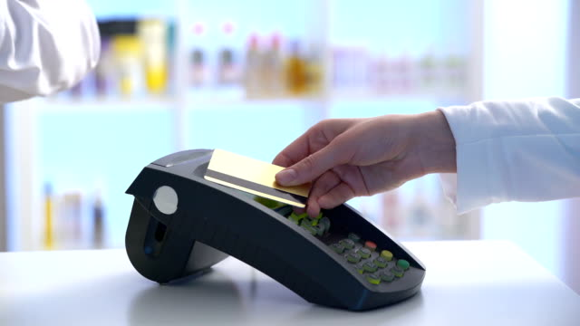 vídeos de stock e filmes b-roll de payment in a trade with nfc system and contactless card - paying with card contactless