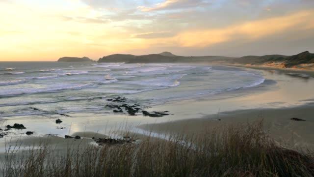 Peaceful evening colors of sunset over ocean coast video