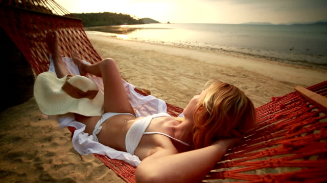 Peaceful woman relaxing on hammock-Tropical beach video