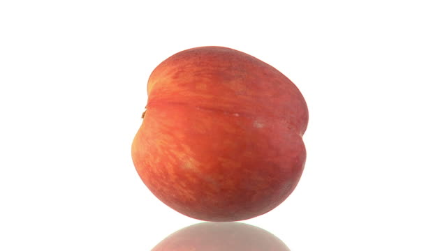 HD LOOP: Peach HD1080p: ENDLESS LOOP of a rotating peach with a reflection on the floor. Isolated on a white background. peach stock videos & royalty-free footage