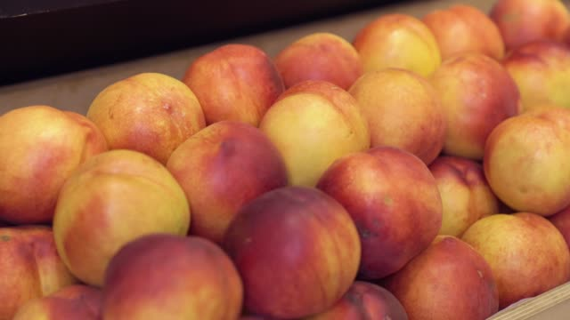 Peaches In The Market Peaches in the market on the market shelf closeup camera movement camera movement nectarine stock videos & royalty-free footage