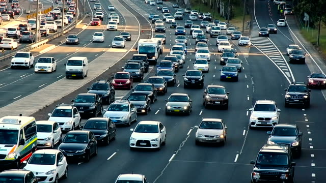 Peak hour of Sydney traffic View of Sydney traffic moving on freeway at North Sydney, 6.30 pm, Friday afternoon, peak hour, 19 February 2016.  Taken from an overpass. oceania stock videos & royalty-free footage