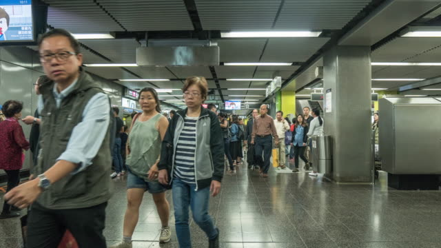 Peak hour on Hong Kong's MTR system. crowd at train station in Hongkong video
