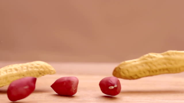Peanut drop in macro and split in super slow motion video