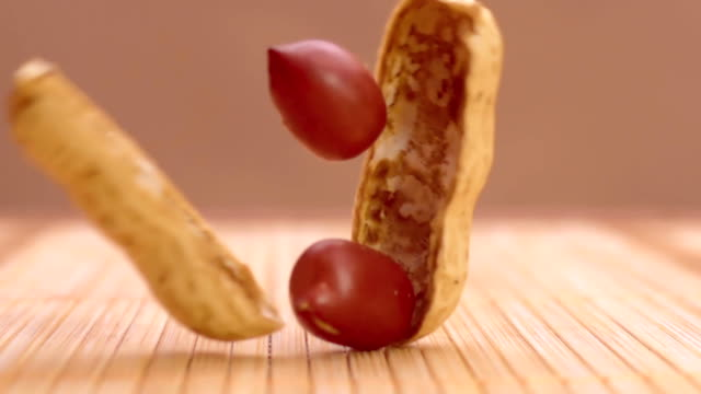 Peanuts drop in macro and split in super slow motion video
