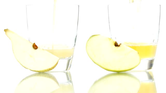 pear and apple juice poured in to the glass isolated on white background pear and apple juice poured in to the glass isolated on white background pear stock videos & royalty-free footage