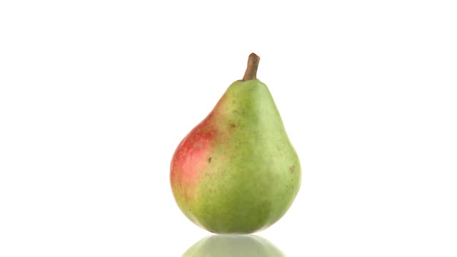 HD LOOP: Pear HD1080p: ENDLESS LOOP of a rotating pear with a reflection on the floor. Isolated on a white background. pear stock videos & royalty-free footage