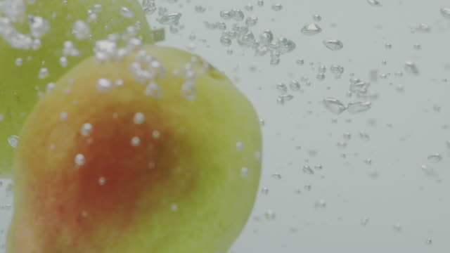 pears falling in water pears falling in water pear stock videos & royalty-free footage
