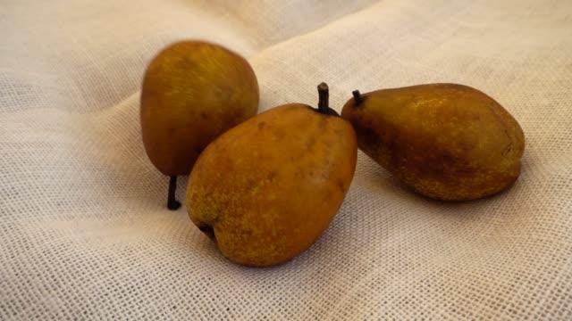 Pears falling on burlap. Slow motion.