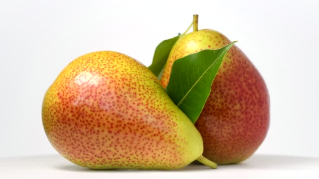 Pears rotating on white background