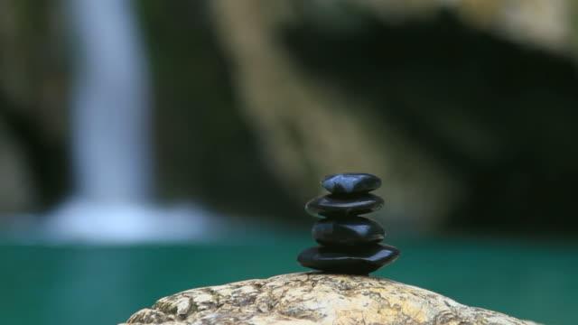 Pebble stones over waterfall video