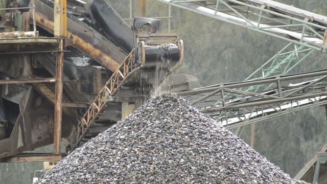 Pebbles conveyor in a quarry putting down stones over a pebbles mountain Pebbles conveyor in a quarry putting down stones over a pebbles mountain construction vehicle stock videos & royalty-free footage