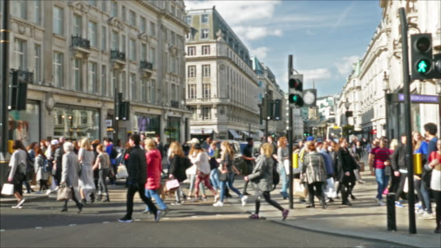A pedestrian crossing Oxford Oxford Street. Oxford Circus, busy intersection with Regent Street, View of Oxford Street, A pedestrian crossing Oxford Oxford Street. Oxford Circus, busy intersection with Regent Street, is the biggest shopping street in Europe, visited by millions of tourists european culture stock videos & royalty-free footage