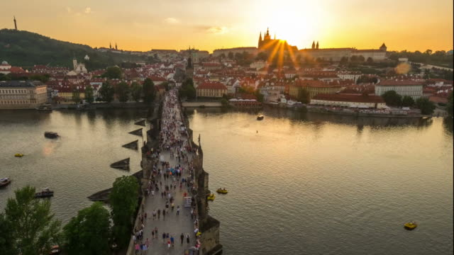 Pedestrian Crowded Charles Bridge Czech aerial at sunset video