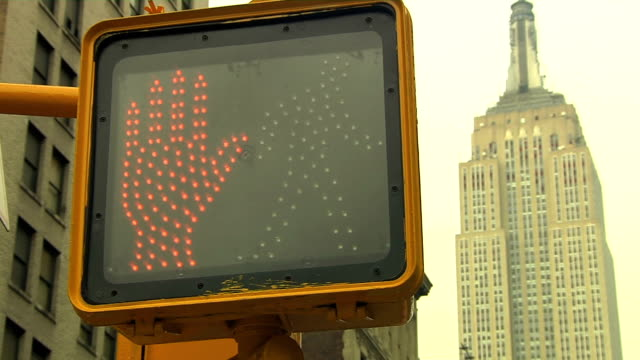 pedestrian signal in front of empire state building video