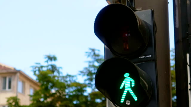 Pedestrian traffic lights - green and red , urban atmosphere