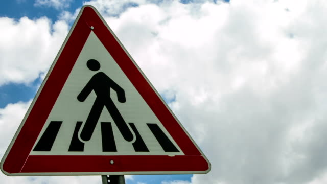 Pedestrian Traffic Sign with Cloudy Sky