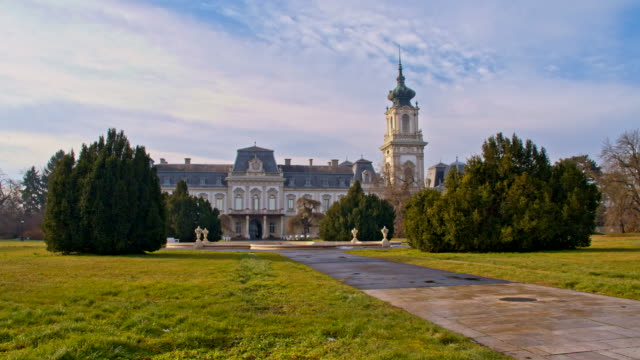 DS Pedestrian walkway in front of the Festetics Palace Dolly shot a pedestrian walkway through the park in front of the Festetics Palace. The Festetics Palace is a Baroque palace located in the town of Keszthely, Zala county, Hungary. mansion stock videos & royalty-free footage