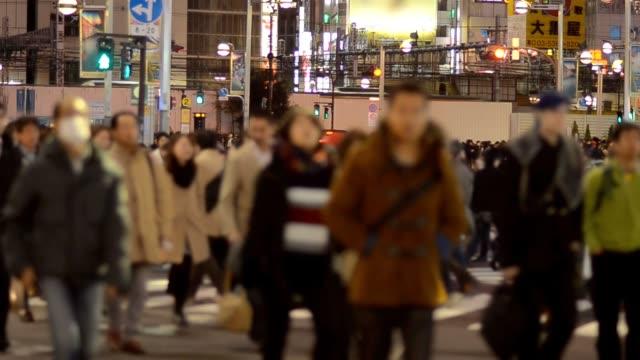 Pedestrians and businessperson crosswalk at Shinjuku video