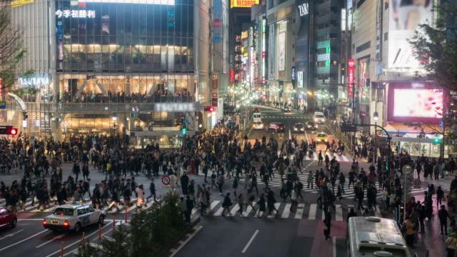 Pedestrians cross at Shibuya Crossing video