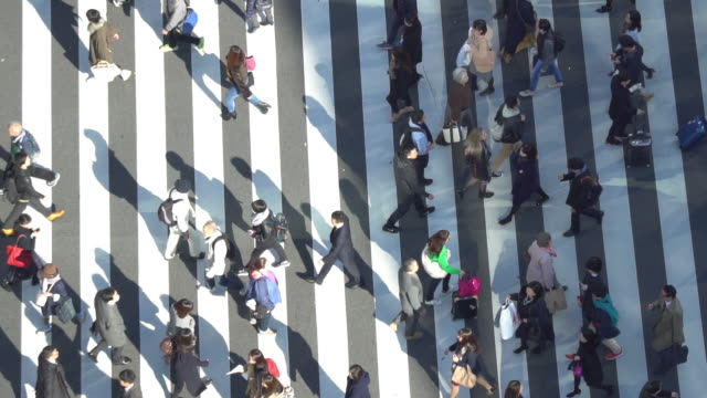 Pedestrians crossing Ginza intersection - slow motion video