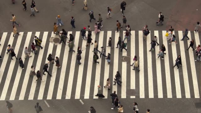 Pedestrians crossing Shibuya day time - slow motion