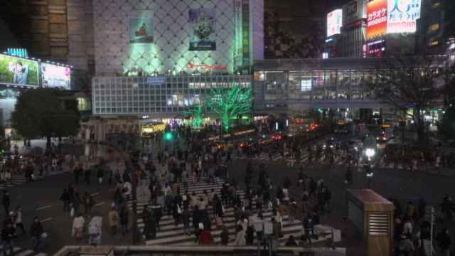Pedestrians crossing street at Shibuya intersection video
