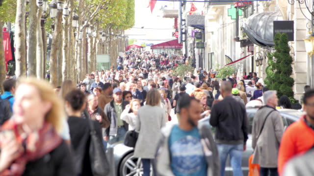 Pedestrians on a crowded avenue in summer