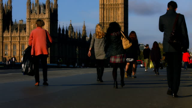 Pedestrians on Westminster Bridge in early morning light video