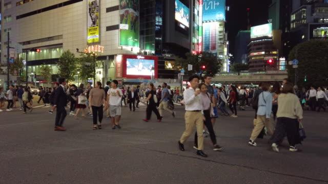 4K Pedestrians walk at Shibuya crossing in Tokyo , Japan . 4K Pedestrians walk at Shibuya crossing in Tokyo , Japan . general view stock videos & royalty-free footage