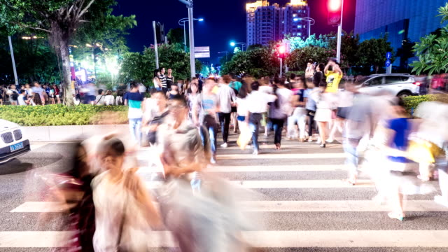 pedestrians walking at zebra crossing in urban city guangzhou street,time lapse. video