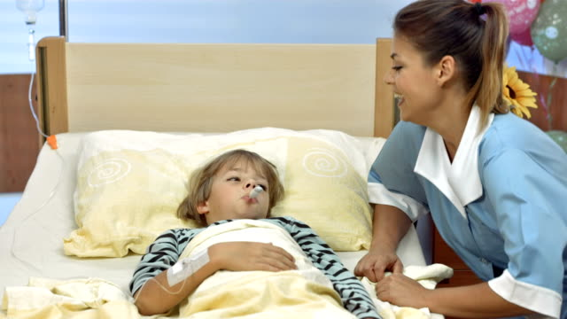HD DOLLY: Pediatric Nurse Taking An Oral Temperature video