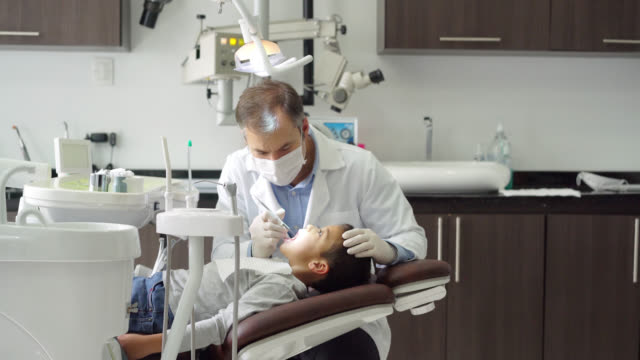 pediatric odontologist checking his little patients teeth - dentist stock videos & royalty-free footage