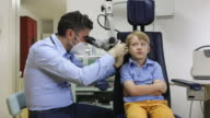 istock Pediatrician examine boy's ear 1271195086