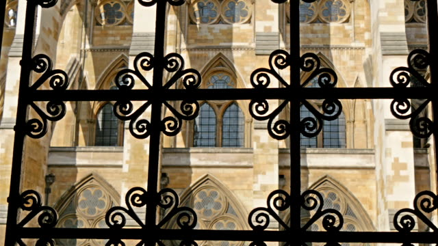 A peek of the Westminster Abbey from the gate A peek of the Westminster Abbey from the gate Showing the beautiful architectural design of the church royalty stock videos & royalty-free footage