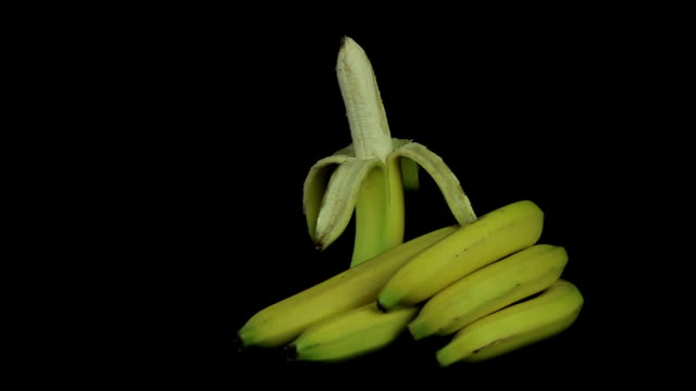 Peeled banana rotates on a black background Peeled banana rotates on a black background peeled stock videos & royalty-free footage