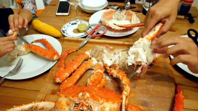Peeling and cutting a crab