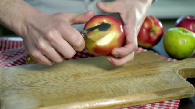 Peeling apple. Hands cut peel apple. Healthy food. Vegetarian food Peeling apple. Hands cut peel apple. Process cutting peel of fresh apple. Ingredients to baking apple cake. Healthy food. Cleaning apples with special knife for cleaning fruits. Vegetarian food peeled stock videos & royalty-free footage