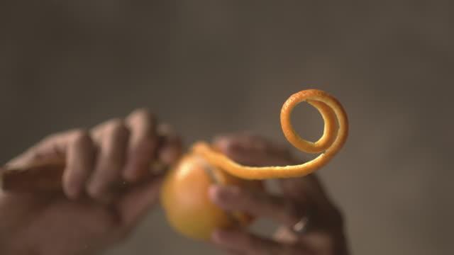 peeling orange - apelsin bildbanksvideor och videomaterial från bakom kulisserna