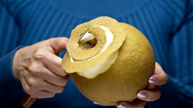 Peeling Pear Peeling Asian Pear. pear stock videos & royalty-free footage