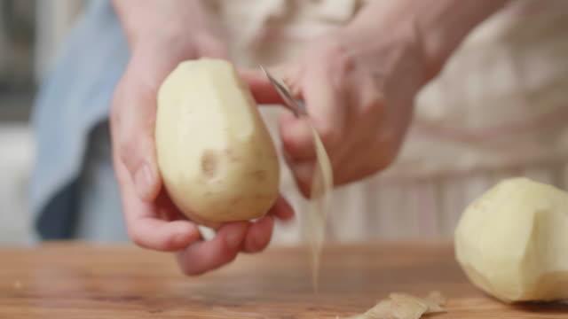 peeling potatoes close up shot Chef peeling potatoes peeled stock videos & royalty-free footage